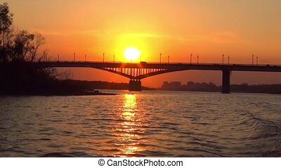 the town bridge over the river at sunset