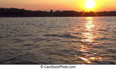 sunset, shore, on Board the boat. the movement through the...