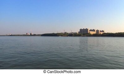 coast near the Siberian city from the deck of a river boat