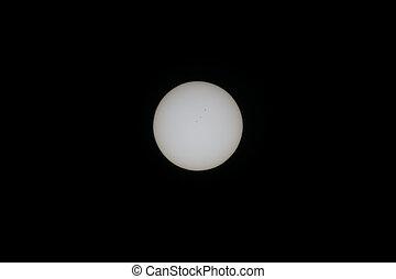 sun and sunspots seen through solar filter