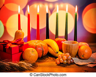 Kwanzaa festive concept with seven candles red, black and...