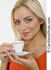 A cup of coffee - The portrait of young blonde woman with a...
