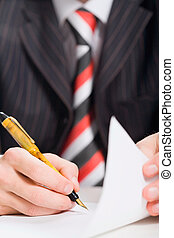 Signing a document - Close up of mans hand signing a...