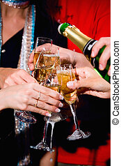 Pouring a champagne - Photo of a champagne pouring into the...