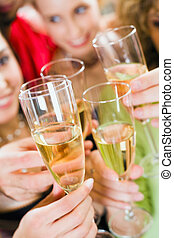 Cheers - Close-up of a wineglasses in a celebration clink