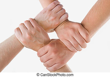 Friendship - Conceptual image of crossed hands isolated over...