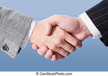 Making an agreement - Close-up of shaking hands making an...