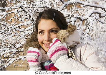 Smiling positive girl among winter twigs - Smiling girl...