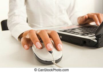 One-click management - Woman?s hands touching computer mouse...