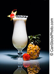 Pina Colada cocktail with cherry surrounded by pineapple and...