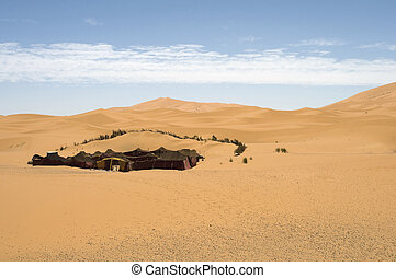 Living in the desert. - Berber tent in the dunes of the...
