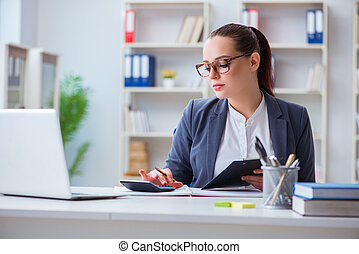 Accountantworking in the office with calculator