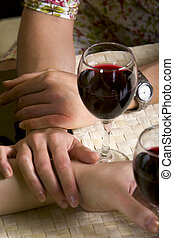 Friendly support - Human hand holding glass of red wine and...