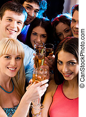 Group - Image of smiling friends holding alcoholic drinks...