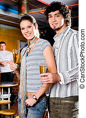 Couple in a bar - Portrait of young couple standing and...