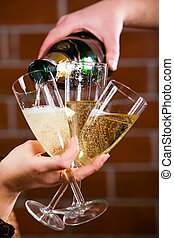 Pouring a champagne - Photo of pouring a champagne on the...