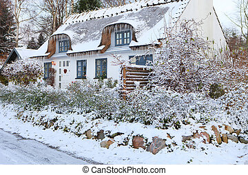Snow covered cottage in Denmark