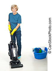 Senior woman using vacuum cleaner