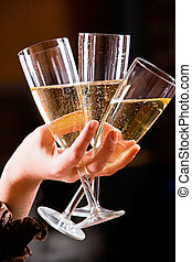 Three glasses of champagne - The glasses of champagne in the...