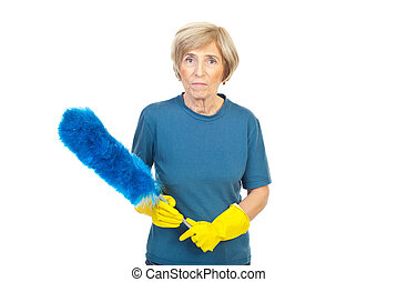 Cleaning woman holding dusty brush - Senior cleaning woman...