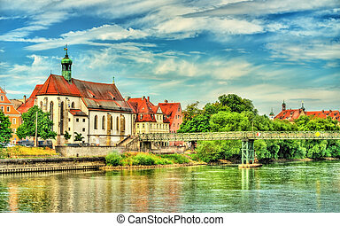 St. Oswald Church with Eiserner Steg bridge across the...