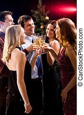Holiday - Group of five friends clinking glasses with each...