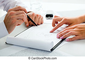 Planning - Image of business peoples hands in a working...