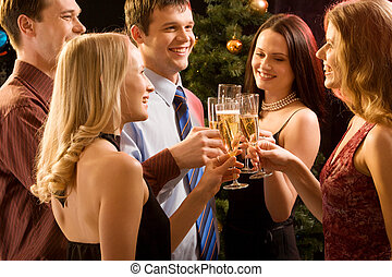 Christmas - Group of people raising up bocals of champagne...