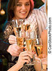 Cheers - Group of champagne glasses clinking together