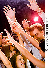 Dancing - Group of young friends dancing at a night club