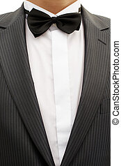 Breast of young man in tuxedo with bow tie - Breast solemnly...