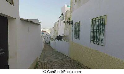 Ancient streets from the stone sidewalk, city of Albufeira....