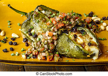 Stuffed Poblano Peppers and Salsa - Close up of fresh...