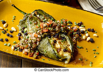 Stuffed Poblano Peppers and Salsa - Close up of roasted...