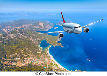Airplane is flying over amazing islands and mediterranean...