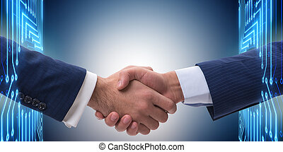Business cooperation concept with two hands shaking
