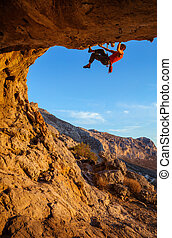 Male climber on overhanging cliff