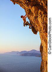 Rock climber on overhanging cliff