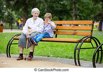 Young boy and his great grandmother using tablet