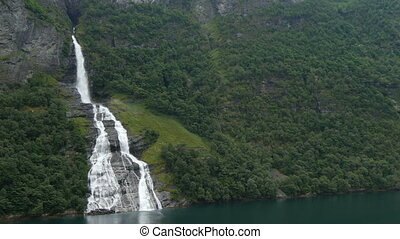 passing waterfall in geiranger fjord - passing waterfall in...