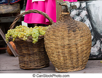 old barrels and tools for wine production and baskets with...