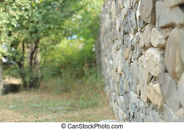Old vintage stone wal with perspective view and blurred background