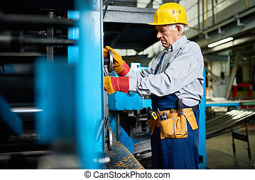Senior Mechanic Repairing Machine Units at Factory