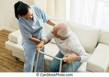 Pleasant friendly caregiver doing her job - Caring about...