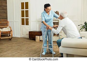 Joyful delighted caregiver smiling to her patient - I will...