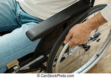 Modern wheelchair being in use - Staying mobile. Modern...