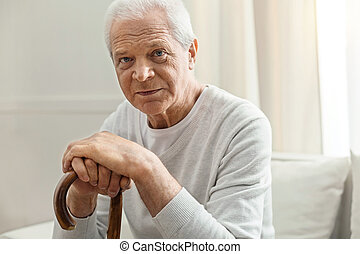 Serious elderly man looking at you - This is age. Serious...