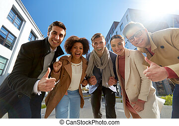 group of people showing thumbs up in city - business,...