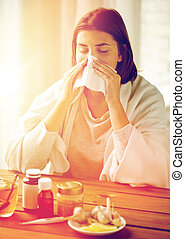 sick woman with medicine blowing nose to wipe - health care,...