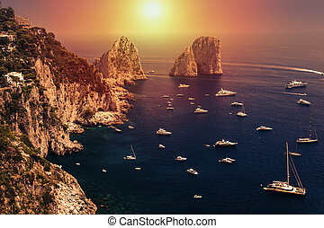 Faraglioni, Capri island, in sunrise light - Faraglioni...